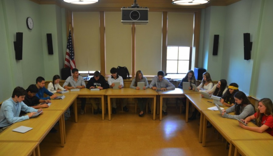 Students use iPads during to complete and in-class essay. Photo by Angela Mauri