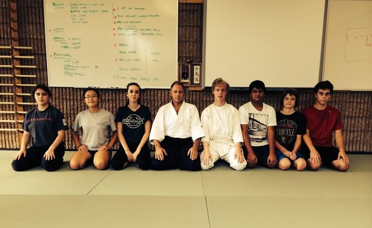 Charles Colten, Director of Community Well-Being, and his Aikido students during a gym class. Charles Colten, Director of Community Well-Being, and his Aikido students during a gym class. Photo courtesy of Charles Colten.