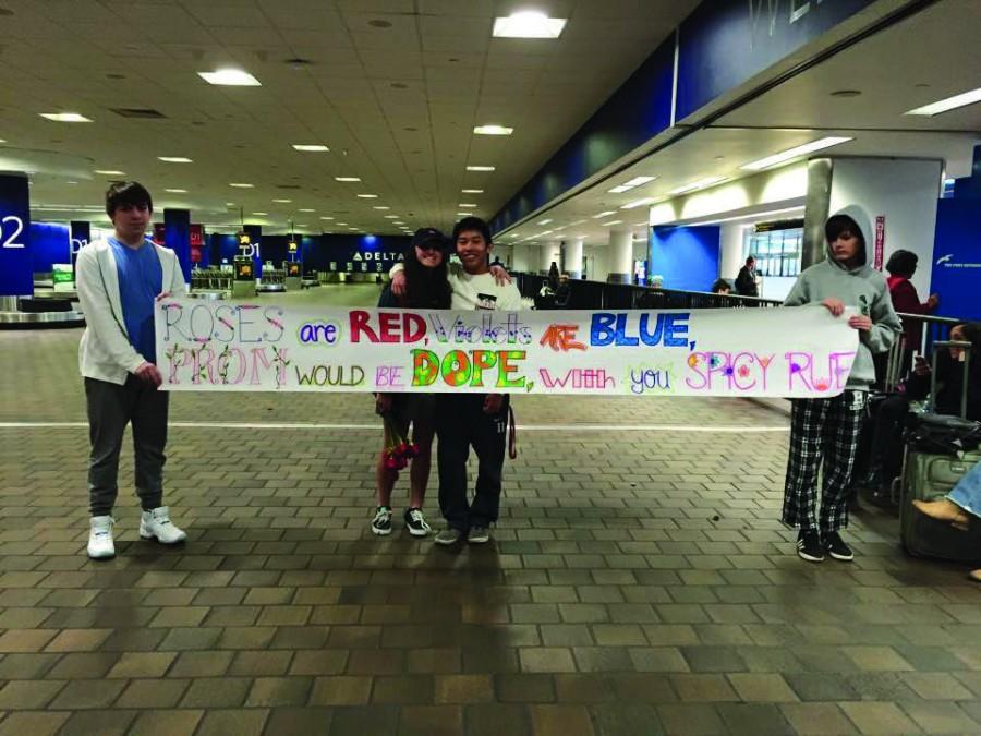Junior Greg Chung asks Junior Kat Cucullo to prom in LaGuardia Airport.
