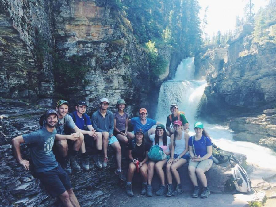 The National Parks Casten trip crew stopped at a waterfall during a hike.