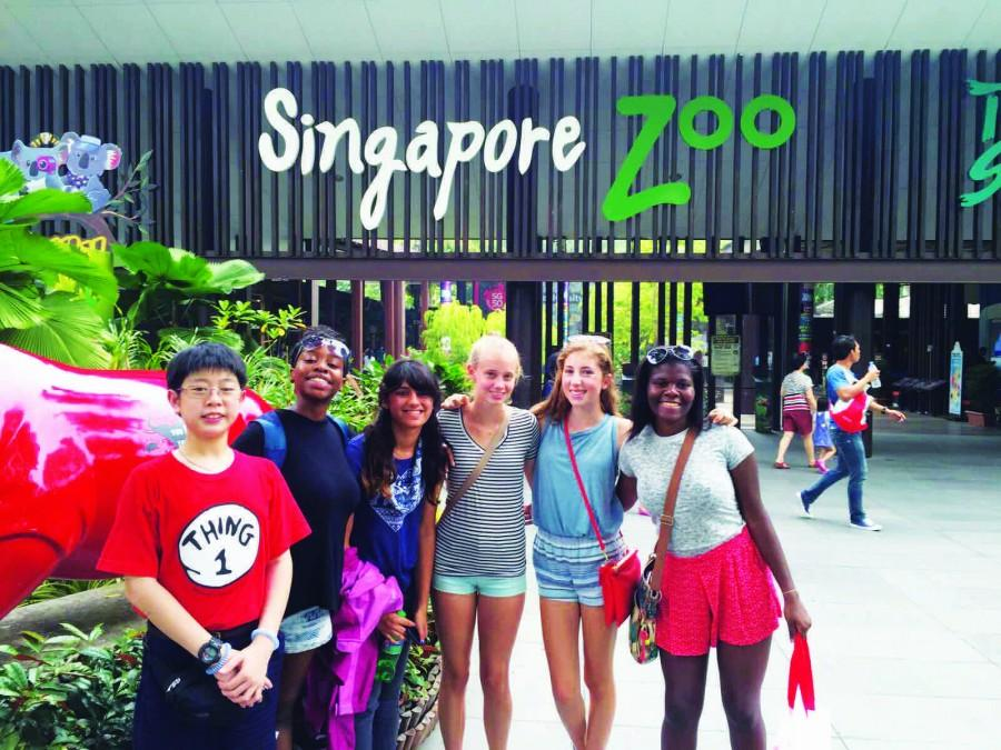 Students pose in front of the Singapore zoo.