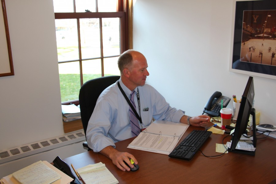New Director of Summer Programs Peter Sawkins sits in his office.