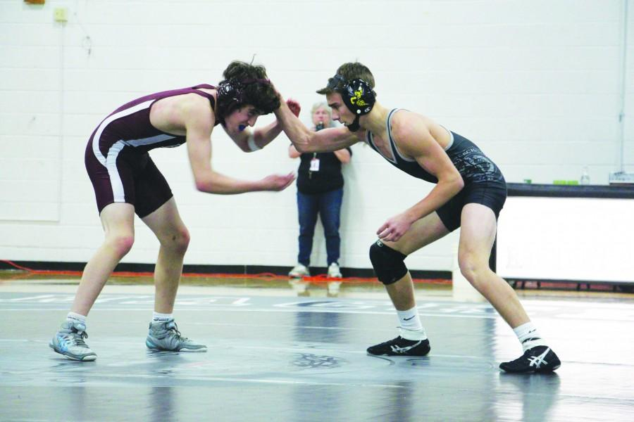 Junior Gabe Welch waits for the right time to strike. He later went on to pin his opponent.