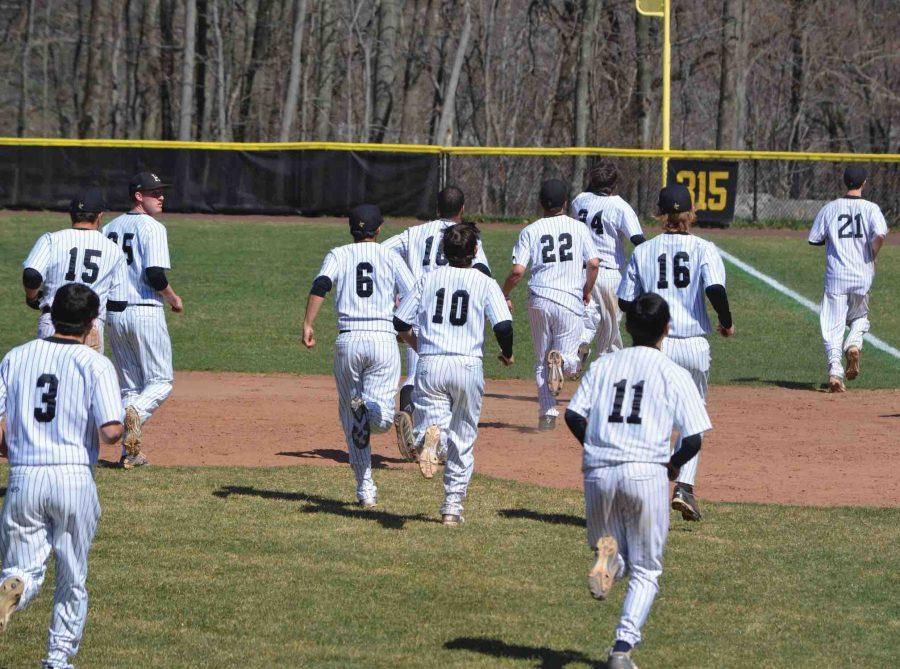 Hackley Boys Varsity Baseball team getting excited for a game during last years season.