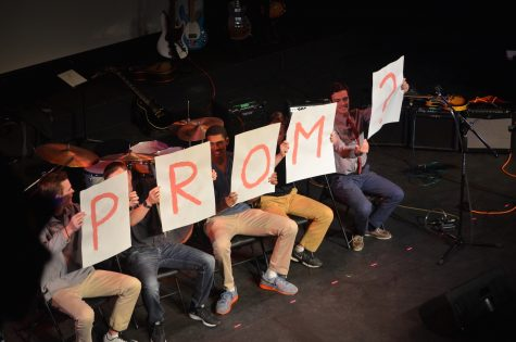 """Senior Eli Pinkus """"promposes"""" to fellow Senior Caterina Moran during one of the most attended school events, Coffeehouse, with the help of 5 friends."""