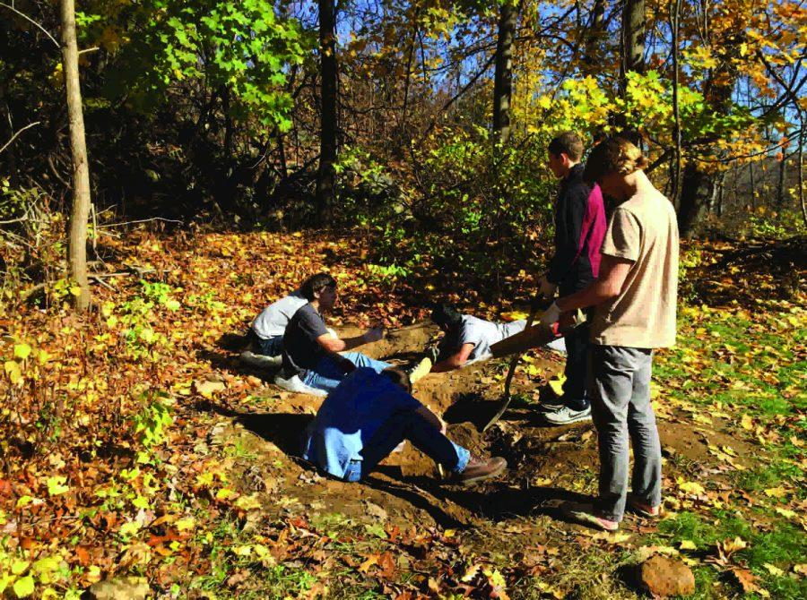 Latin IV students excavate artifacts at their new archaeological dig site.