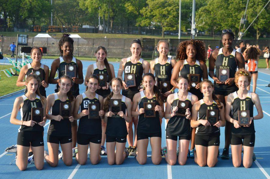The Girls' Track and Field team celebrates after winning their 4th consecutive NYSAIS title.