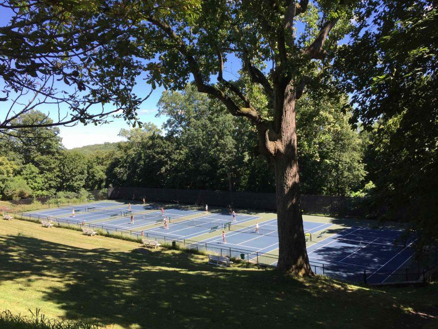 The Girls' Varsity Tennis team practices during Preseason.