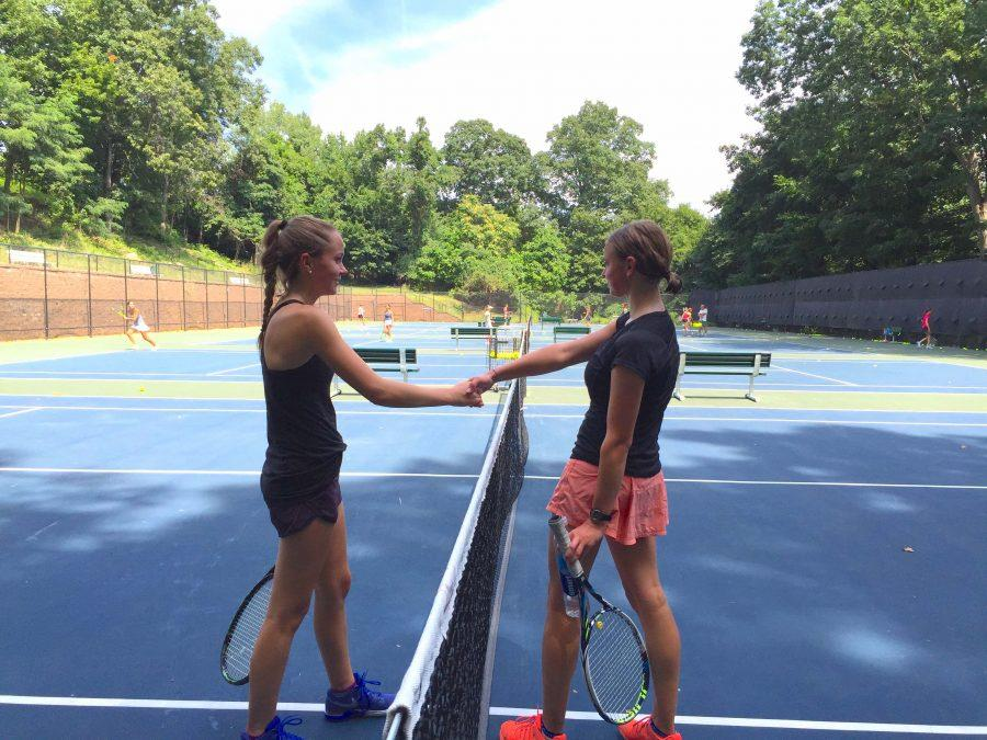 Senior Izzy Sellon and junior Cosima Boettner shake hands after a match.