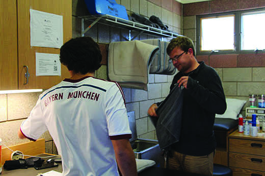 Athletic trainer Nick Imhof spends his afternoon helping injured athletes.