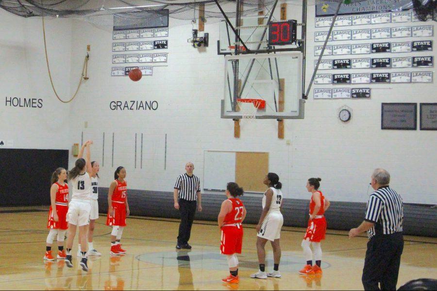 Sophomore Jordan Wade scores against Fieldston in the Girls' Basketball game.