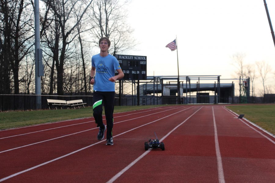 Senior Alex Popov tests out his pacing car on the track at Hackley. He built this car to help him train more efficiently by keeping him on a constant pace.