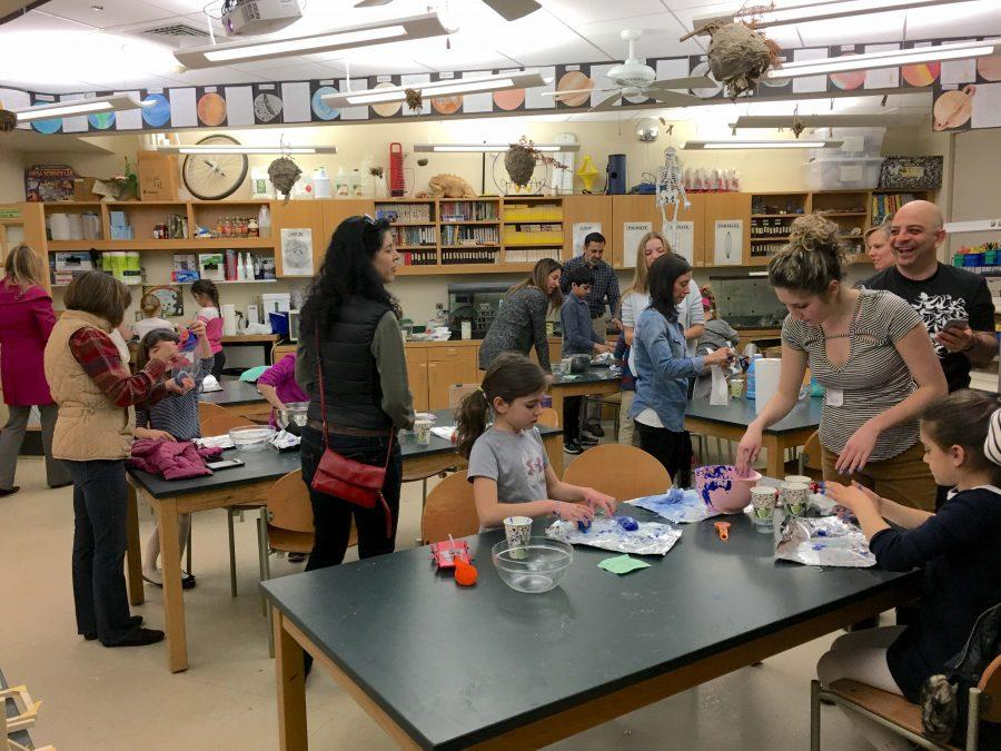 Lower School students and their families make heat-sensitive slime with the help of Advanced Physics students.