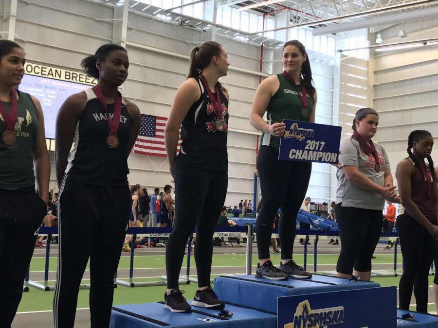Ivie stands on the podium after winning 4th place in the weight throw.