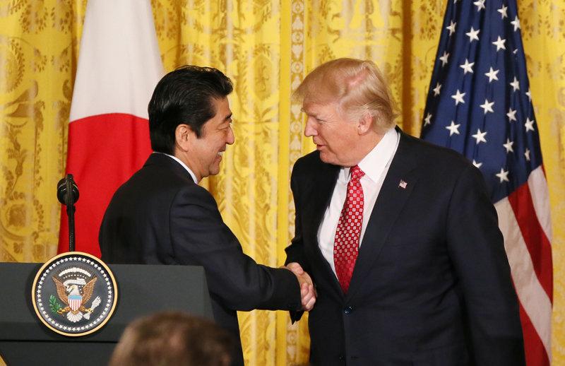 Japanese Prime Minister Shinzō Abe and President Donald Trump shake hands on February 10, 2017.