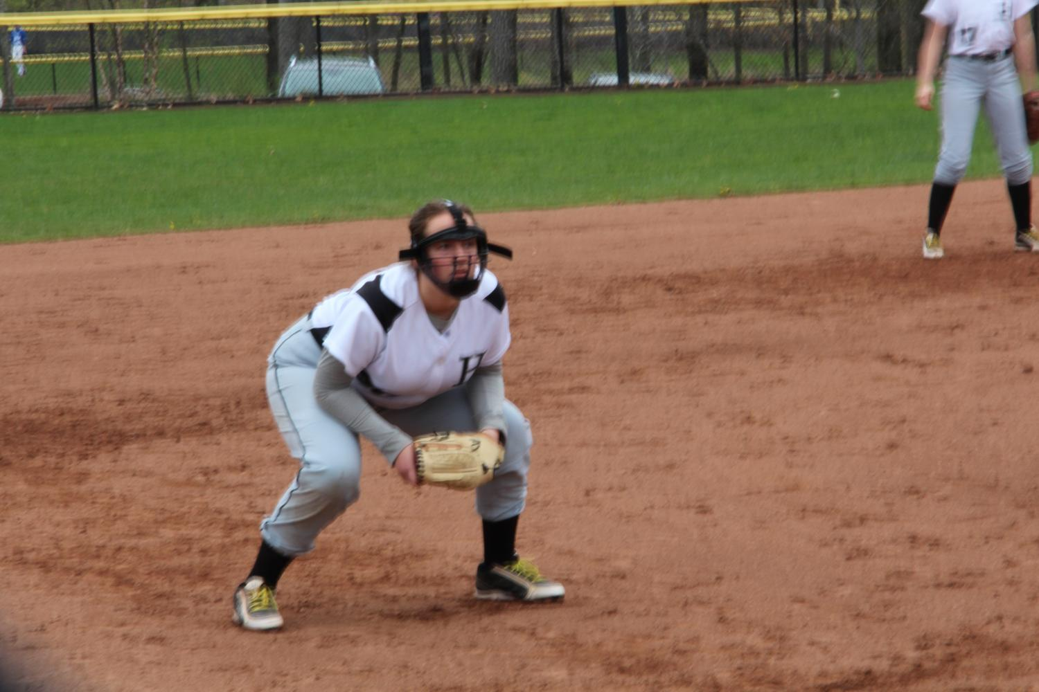 Lauren Ahern squats down in preperation to field a ball.