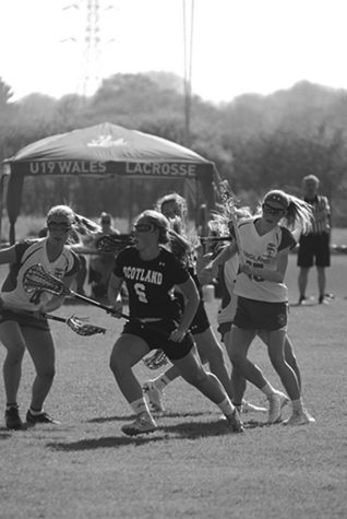 Meghan playing midfield for the Scottish national team.