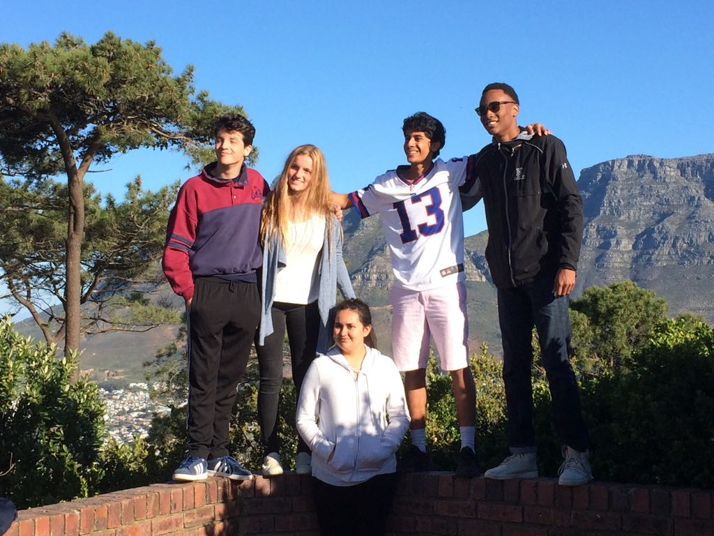 Grant Albright '19, Francesca Doctors '18, Varun Krishna '19, Julian Epps '18, and Paola Garcia '20 pose for a photo on Signal Hill.