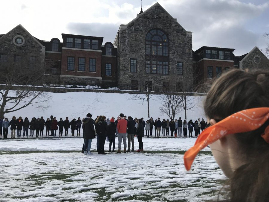 Students and faculty gather around akin common for a 34 second moment of silence.