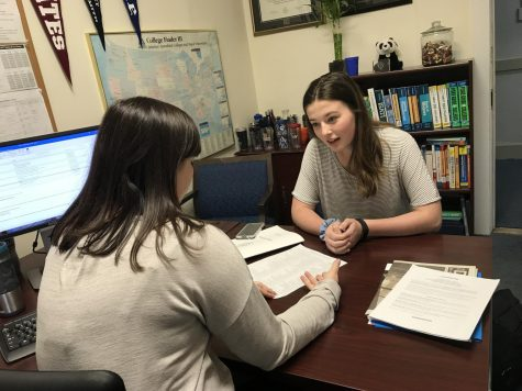 Sophomore Emma Brenna discusses her course plans with college counselor Rebecca Hall. The Class of 2020 is the first grade of the Upper School to be provided with college counselors during sophomore year. Sophomores often ask their college counselors questions about the advantages of taking certain classes.