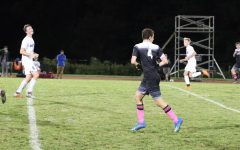 Senior Mattew Braver looks for a pass from his teammate. Braver has scored more than eighteen goals this season. He is a center midfielder and a captain.