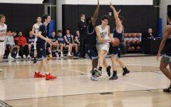 Boys Varsity Basketball fights a hard battle against Poly Prep in the Winter Sting