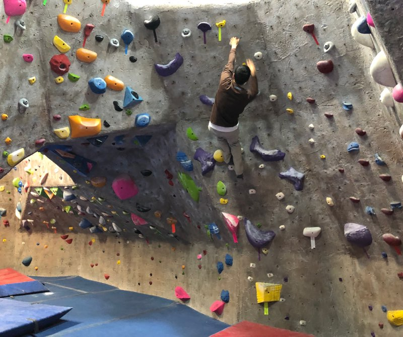 Physics+teacher+and+rock+climbing+club+leader%2C+Dr.+Ying%2C+demonstrates+his+skills+on+the+rock+climbing+wall.+Dr.+Ying+and+his+club+climb+at+The+Cliffs+in+Valhalla+every+Wednesday.+