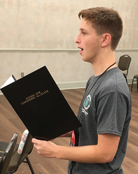 Adam Tannenbaum practices for his singing audition at the New York State School Music Association. Adam takes vocal lessons and practices singing daily.