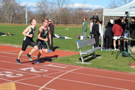 Senior captain William Crainer and Junior Hudson Kelley come to the finish line of the 3200. In their first meet, they both qualified for NYSAIS.