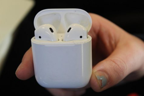 The AirPods sport a compact, unique design with a slim profile case.