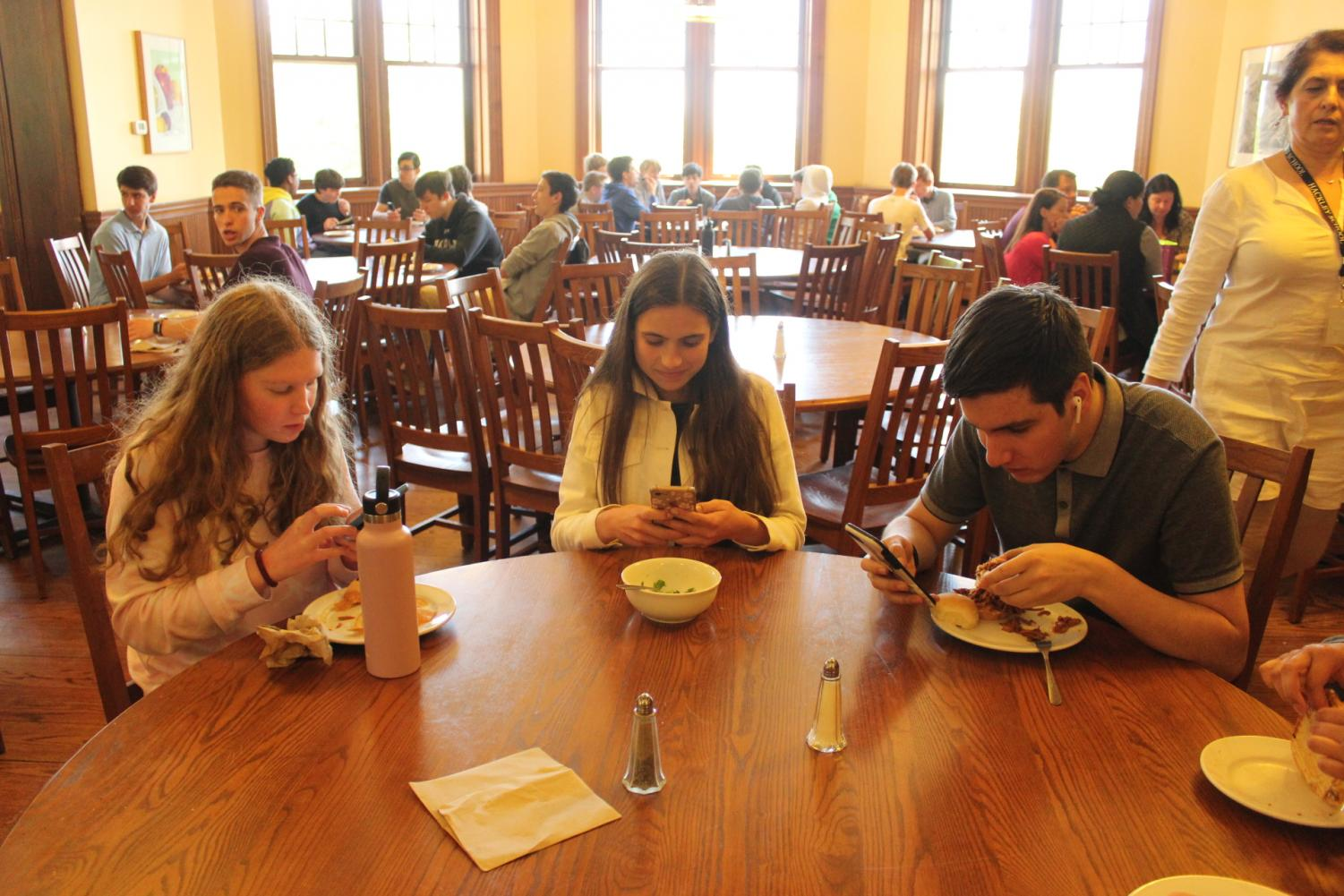 Students glued to their technology during lunch demonstrate the necessity for a day without technology. In recent years, the role of devices has become more prominent both in and out of the classroom.