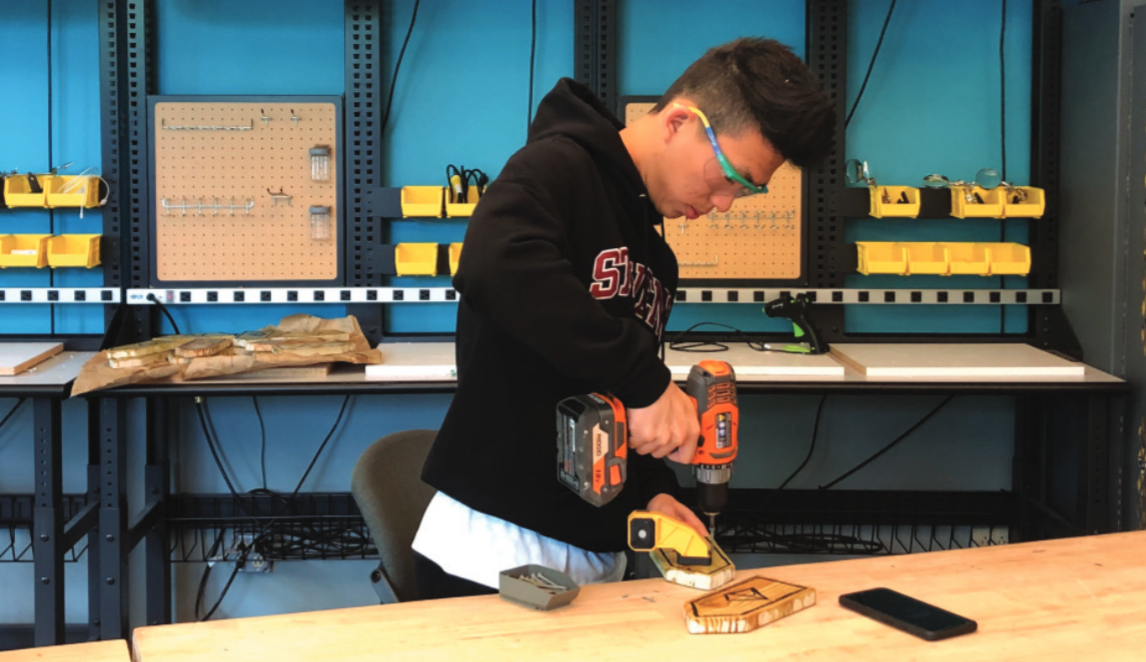 Senior Jack Chen takes advantage of the school's new Makerspace while working on his senior project. Senior projects allow students to explore their interests in a variety of settings both on and off campus.