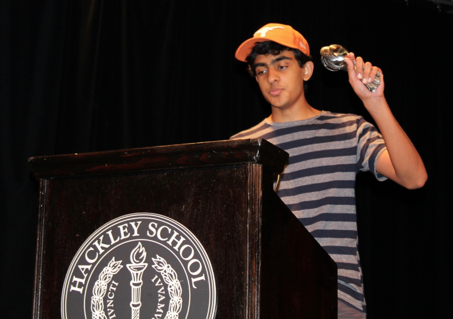 Arav Misra holds up twenty four spoons, representing the limited time we have in a day. He argues that school eats up every chunk of student life as it is so we should try to stop obsessing over the minutia of life.