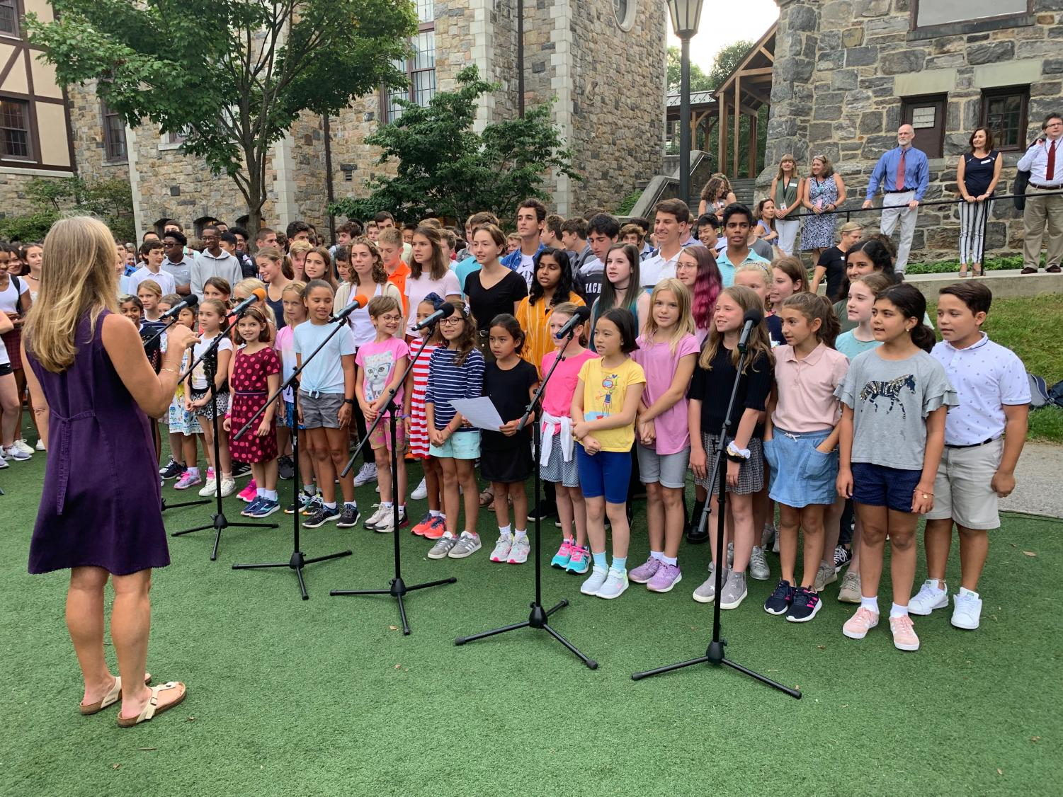 Upper School chorus teacher May Steinberg directs lower and upper school chorus students in their singing of the Hackley Alma Mater. The song was followed by speeches from Taylor Robin and Head of School Mr. Wirtz. This tradition marks the beginning of the school year which is bookended by a Commencement ceremony.
