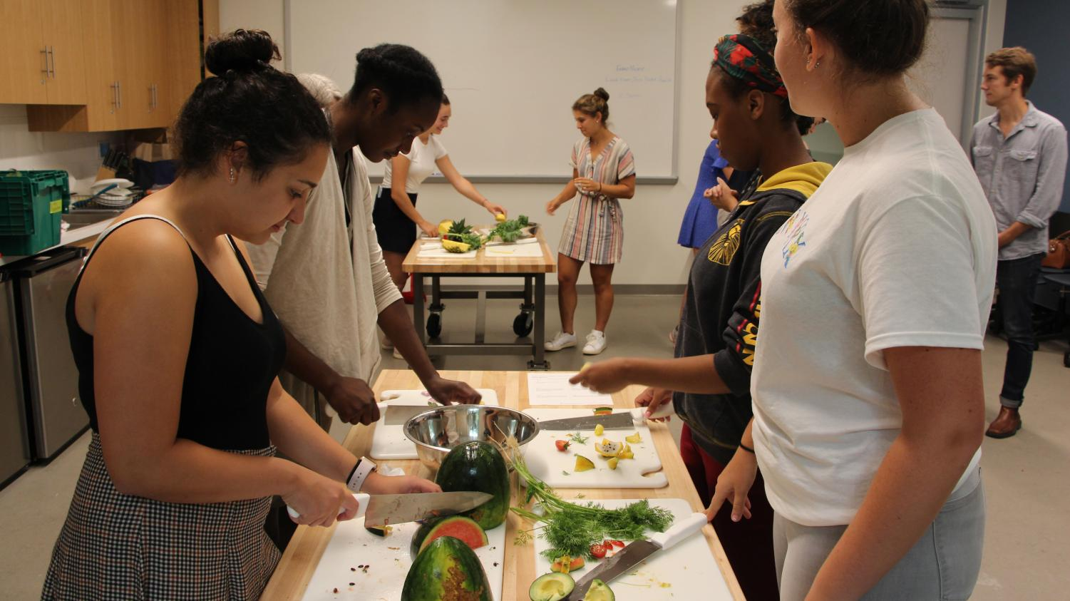 Students cut and prepare the fresh fruits and vegetables that they will put in their salads. After gathering the ingredients, the Stone Barns educators discussed the concept of emulsions and making a dressing that has a healthy balance of oil and an emulsifier.