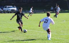 JV Soccer captain Theo Yannuzzi dribbles past defenders in Hackley's game against Horace Mann.