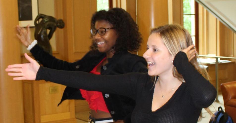 Senior Class President Taylor Robin (left) and Leah McKirgan (right) film a TikTok in the senior lounge.