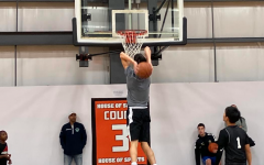 Senior Matthew Wiele warming up with a dunk for Hackley's House of Sports AAU fall basketball tournament.