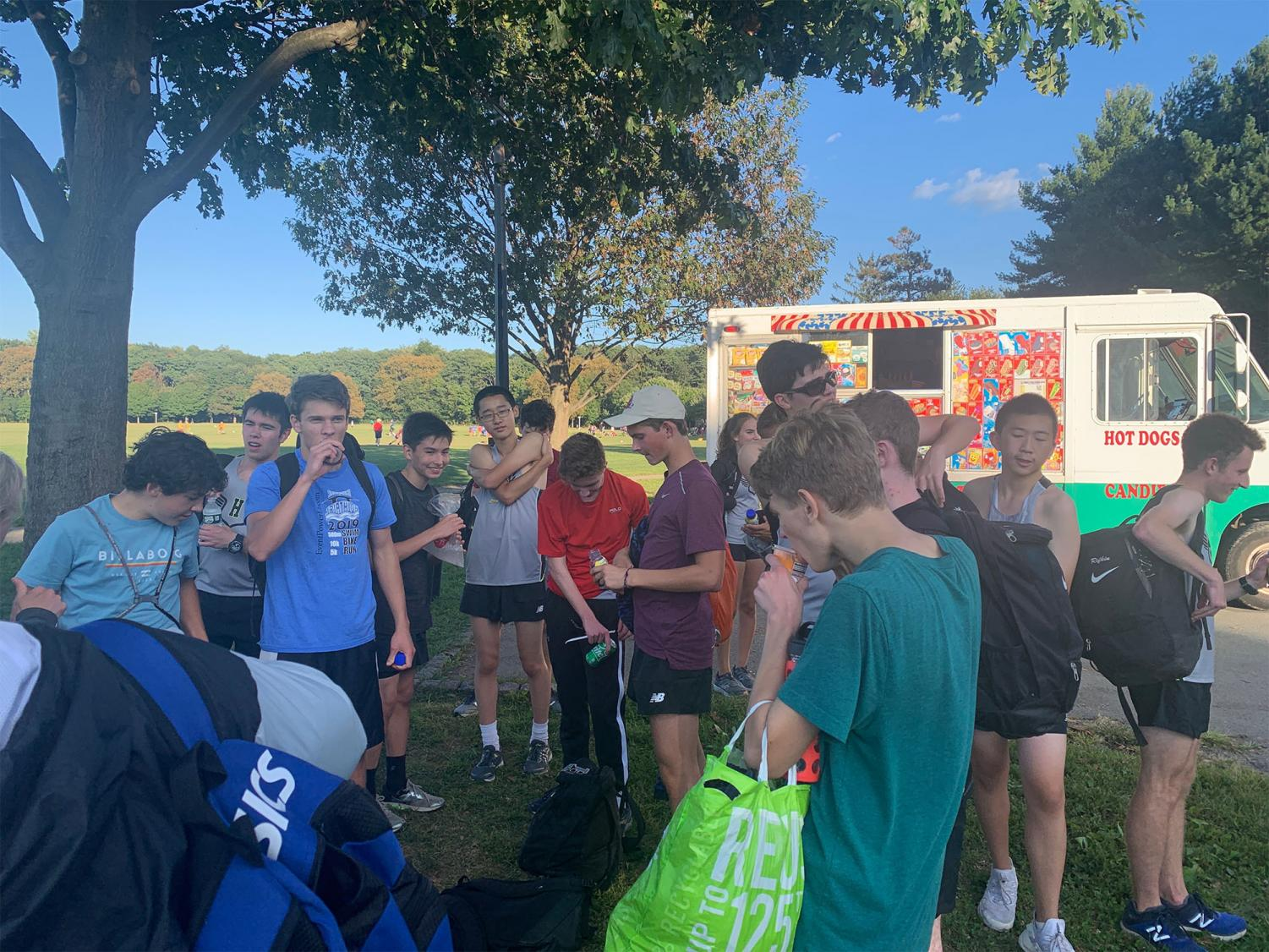 The boys Cross Country team enjoys post-race drinks and snacks as a group.