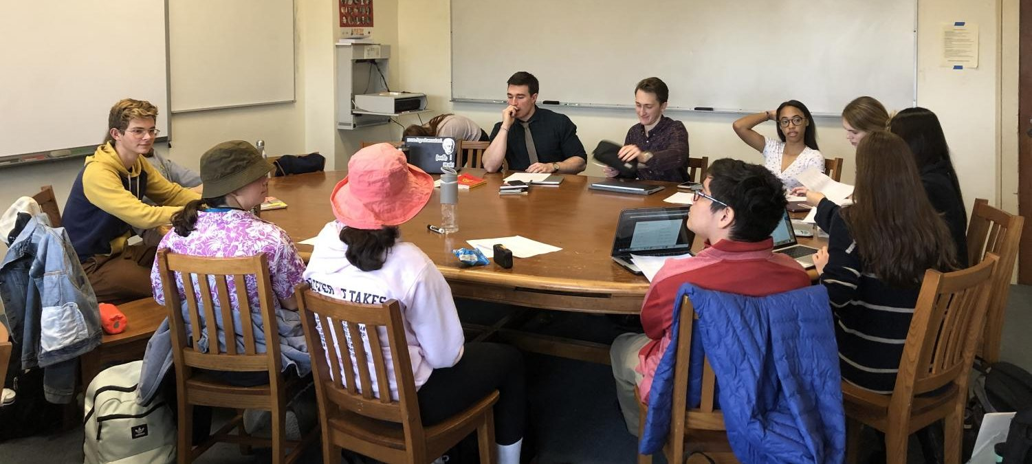Students in the independent research course meet with Mr. Flanigan to talk about their respective topics. At this point in the year, class members have compiled sources that have helped them to learn more about their historical and literature interests.