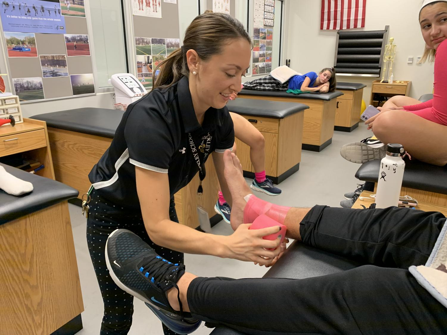 Katie works with Freshman Dan Paridis to get him ready for his soccer game. Before Kayla came to Hackley she was an athletic trainer at Rockland Community college. She graduated from SUNY Cortland in 2017 and is currently pursuing a master's degree in Nutrition and Dietetics to become a Registered Dietitian as well as a Certified Athletic trainer.