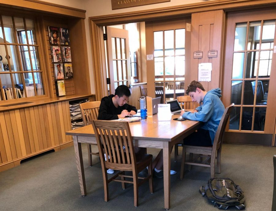 Students+work+in+the+library+with+their+phones+right+by+their+side.+Although+some+students+use+their+phones+as+calculators+or+look+at+photos+of+notes%2C+many+just+enjoy+having+their+phones+by+their+side.+%0A