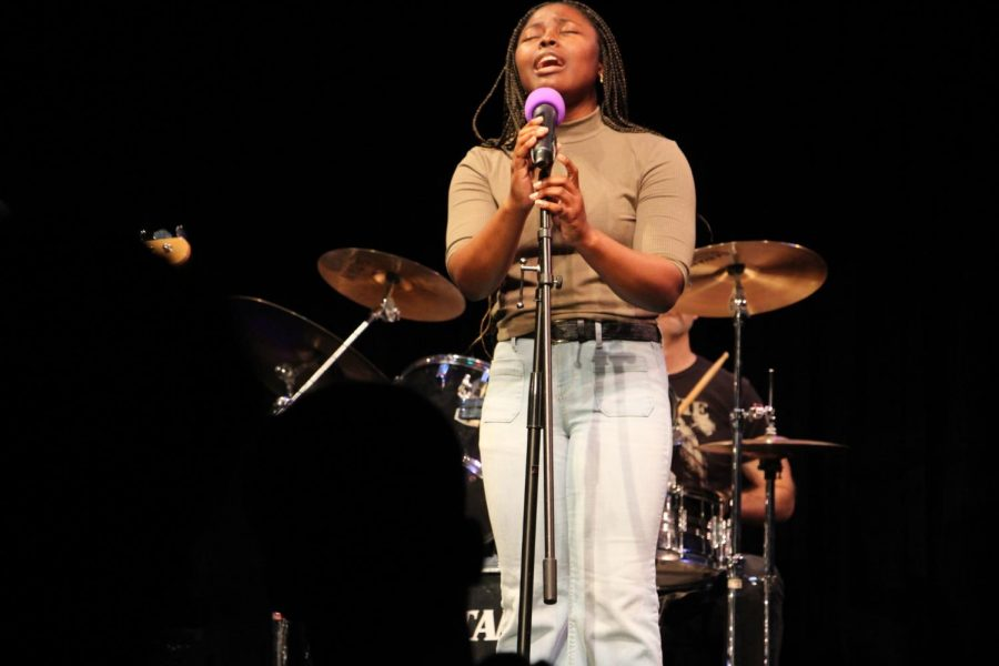 Senior Tajah Burgher closes her eyes to connect deeply with the song that she performed on Friday night. Her strong vocals captivated the audience and filled the PAC. This Winter, she decided to sing Sia's
