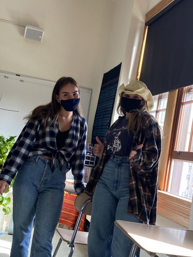 Seniors Hannah Ostfield and Mackenzie Jones wear western outfits featuring blue denim jeans, flannels, and a cowgirl hat!