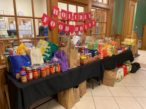 To participate in the Holiday Food Drive, there is a collection table outside of Ms. Coy