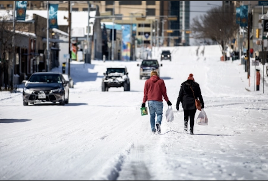 Photo credits: Rolling Stone. This image shows Texans walking through frigid weather to get their groceries.
