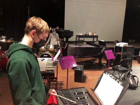 Freshman Jake Byrne plays a xylophone and Lucas Caramanica plays a drum set. COVID-19 restrictions have forced students in band to make music in a different way than they did before the pandemic.