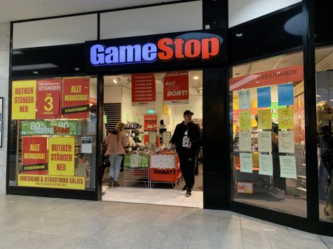 Customers walk out of gamestop, the recent focus of a financial fiasco on Wall Street.