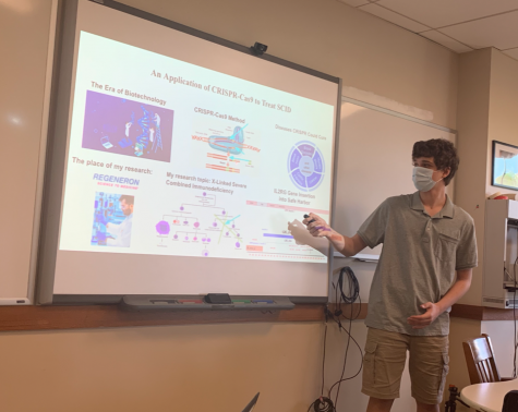 Junior Mike Potanin presents his IRP project to the class. Here, he is talking about the application of CRISPR-Cas9 to treat SCID. SCID is a disease results in a weak immune system that is unable to fight off even mild infections.